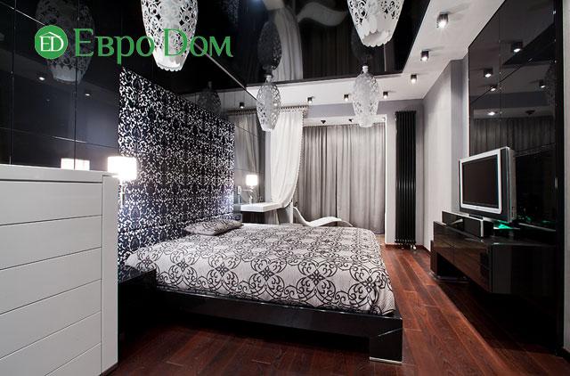 На фото: спальня с современным интерьером