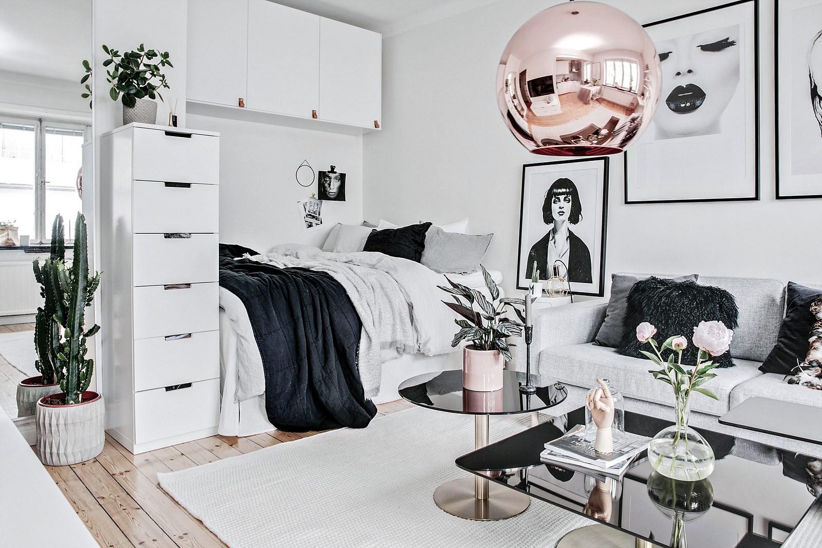 Дизайн квартиры в скандинавском стиле с кроватью и диваном
