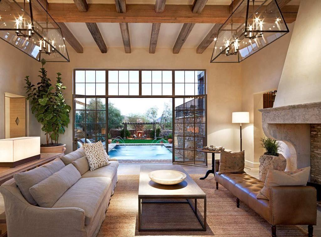 Дизайн гостиной с камином в средиземноморском стиле