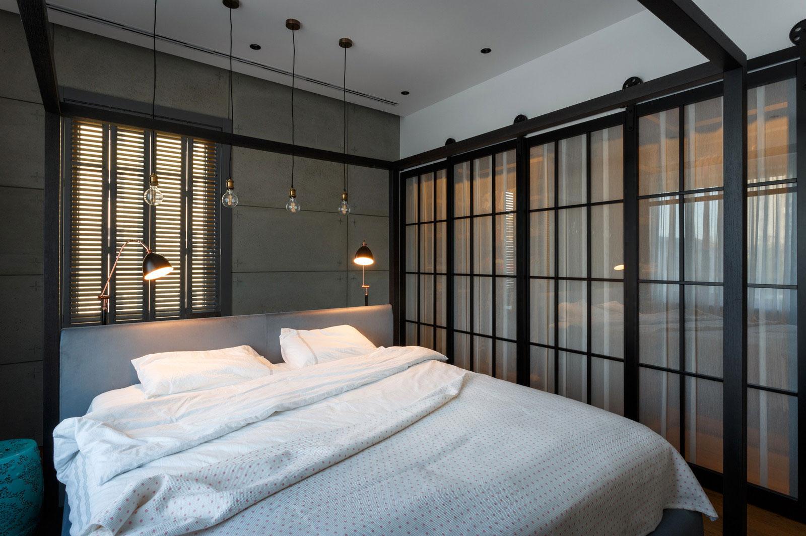 Интерьер маленькой серой спальни